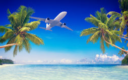 Airplane Flying Over Tropical Beach Travel Concept Royalty Free Stock Image