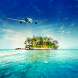 Airplane flying over tropical ocean landscape. Thailand travel. Airplane flying over amazing ocean landscape with tropical island. Thailand travel destinations royalty free stock image