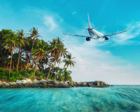 Airplane flying over tropical ocean landscape. Thailand travel Royalty Free Stock Photo