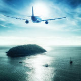 Airplane flying over tropical ocean landscape. Thailand travel Stock Images