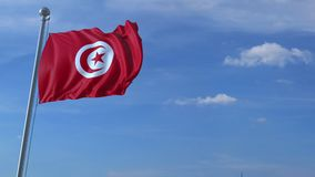Airplane flying over waving flag of Tunisia. Commercial airplane flying over waving flag of Tunisia stock video footage
