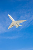 Airplane Flying Overhead with Blue Sky Stock Images