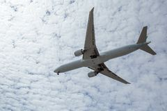 Airplane flying overhead Stock Image