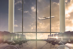 Airplane flying past departures lounge window Stock Images