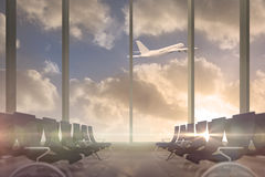 Airplane flying past departures lounge window Stock Photography