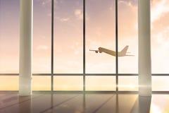 Airplane flying past window at sunrise Stock Photo