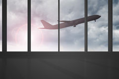 Airplane flying past windows Royalty Free Stock Photography