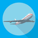 Airplane flying with shadow Stock Photo