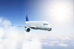 Airplane flying in the sky Royalty Free Stock Photos