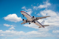 Airplane flying on the sky Royalty Free Stock Image