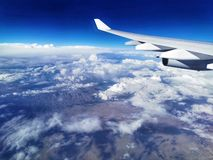 Airplane flying in the sky stock images