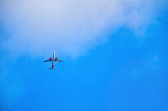 Airplane flying in the sky Stock Image