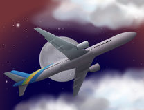 Airplane flying in the sky at night Stock Images