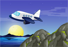Airplane flying in sky at night Stock Images