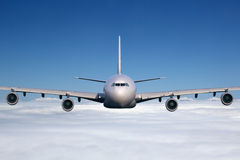Airplane flying in the sky Royalty Free Stock Photography