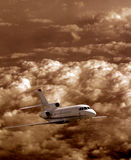 Airplane flying. In the sky over stormy clouds stock photo