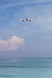 Airplane flying in the sky in phuket island. Airplane flying in the sky in phuket thailand Royalty Free Stock Photos