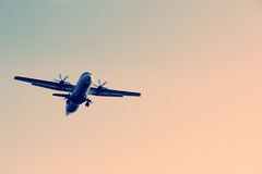 An airplane flying in the sky Stock Photography