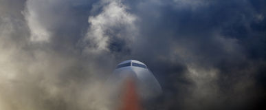Airplane flying through storm Royalty Free Stock Photo