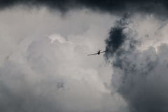 Airplane Flying Into Stormy Clouds/Sky Royalty Free Stock Images