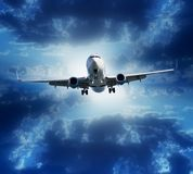 Airplane flying on stormy cloudy sky background Royalty Free Stock Photo