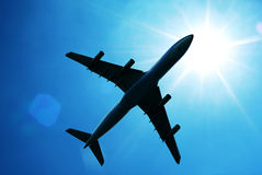 Airplane flying sun sky Stock Photo