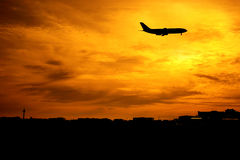Airplane flying at sunset Royalty Free Stock Image