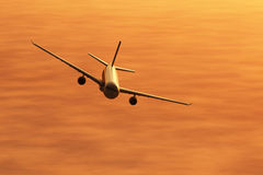 Airplane flying in the sunset 3D render Royalty Free Stock Photo