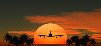 Airplane flying at sunset over the palms. Airplane flying at sunset over the tropical land with palm trees Stock Photography