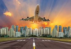 Airplane flying take off from runway  on sunset Stock Photos