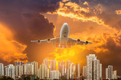 Airplane flying take off from runway on sunset Royalty Free Stock Photography