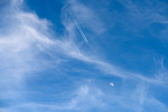 Airplane Flying To The Moon Concept On Blue Sky Stock Photos