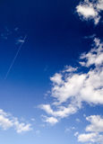 Airplane flying to the stratosphere. In the deep blue sky and clouds Stock Image