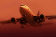 Airplane in fog Stock Photo