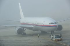 Airplane in a foggy day Royalty Free Stock Photography