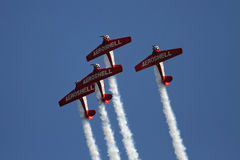 Airplane formation demonstrates flying skills Stock Images