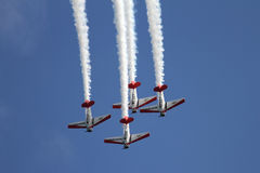 Airplane formation demonstrates flying skills Royalty Free Stock Photo