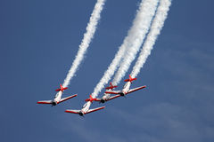 Airplane formation demonstrates flying skills Royalty Free Stock Image