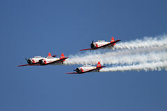 Airplane formation demonstrates flying skills and Royalty Free Stock Photo