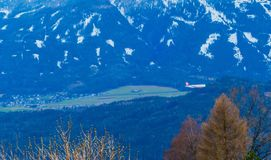 Airplane in Front of Alps Austria royalty free stock photography