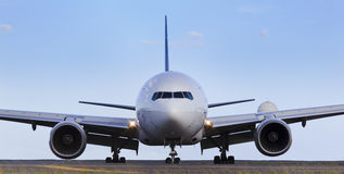 Airplane Front Day. Airplane front close-up view airfield ground day time blue sky clear background Stock Photography
