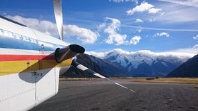Airplane in front of snowy mountains Royalty Free Stock Image