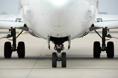 Airplane front view at the air. Port showing landing gear Stock Images