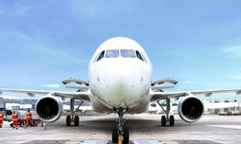Airplane front view at airport. Under blue sky Royalty Free Stock Photography