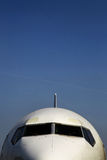 Airplane front view. Color detail with the front side of a passenger airplane Royalty Free Stock Photo