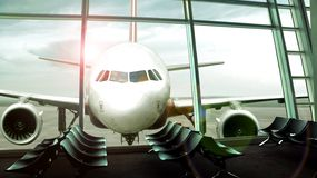 Airplane front view from departure hall Stock Photography