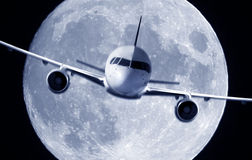 Airplane and a full moon Stock Photo