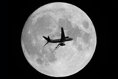 Airplane and a full moon Royalty Free Stock Images