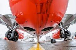 Airplane fuselage and main landing gear repair, bottom view close up. Airplane fuselage and main landing gear repair, bottom view close up Stock Photo