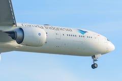 Airplane Garuda Indonesia PK-GIC Boeing 777-300 is landing at Schiphol airport. Royalty Free Stock Photo